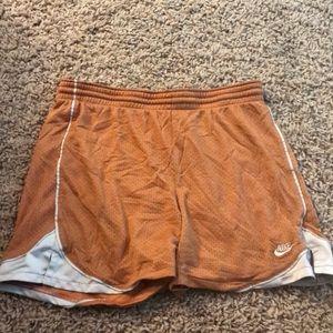 Burnt orange Nike shorts